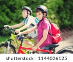 children with rucksacks riding... | Shutterstock . vector #1144026125