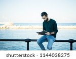 young man read his copy book... | Shutterstock . vector #1144038275