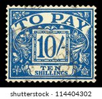 UK - CIRCA 1940: Mail stamp printed in the UK featuring the postage fine of ten shillings to pay, circa 1940 - stock photo