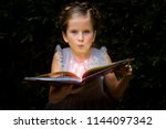 girl with a libromagic | Shutterstock . vector #1144097342