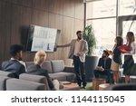 business team on a morning... | Shutterstock . vector #1144115045
