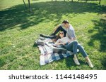 young couple in love resting on ...   Shutterstock . vector #1144148495