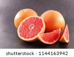fresh red grapefruit | Shutterstock . vector #1144163942