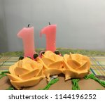 two candles and orange icing... | Shutterstock . vector #1144196252