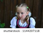 a little girl in the... | Shutterstock . vector #1144207118