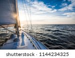 sailing at sunset. a view from... | Shutterstock . vector #1144234325
