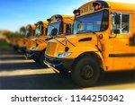 Row Of Yellow School Buses...
