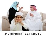 Arabic couple fighting and child suffering - stock photo