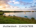 boats and yacht on the pogoria... | Shutterstock . vector #1144267808