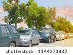 cars parked in a row on street... | Shutterstock . vector #1144273832