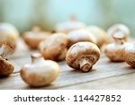 Mushrooms On A Wooden Table....