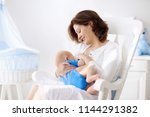 young mother holding her... | Shutterstock . vector #1144291382