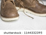 close up vintage leather shoes... | Shutterstock . vector #1144332395
