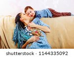 happy little boy playing with... | Shutterstock . vector #1144335092