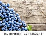 freshly picked blueberries on... | Shutterstock . vector #1144363145