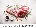 raw fresh lamb meat shank and... | Shutterstock . vector #1144399952