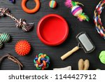 Stock photo flat lay composition with accessories for dog and cat on wooden background pet care 1144427912