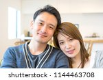 couple full of affectionate... | Shutterstock . vector #1144463708