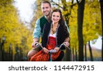 man and woman in southern... | Shutterstock . vector #1144472915