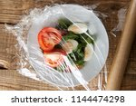 roll of wrapping plastic... | Shutterstock . vector #1144474298