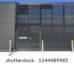 door and metal screen of a... | Shutterstock . vector #1144489985