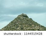 stony hill on the sky background | Shutterstock . vector #1144515428