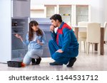 man repairing fridge with... | Shutterstock . vector #1144531712