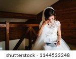 beautiful bride reading letter... | Shutterstock . vector #1144533248