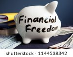 financial freedom written on a... | Shutterstock . vector #1144538342