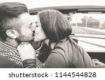 happy couple kissing inside...   Shutterstock . vector #1144544828