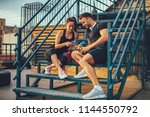 young sports couple choosing... | Shutterstock . vector #1144550792
