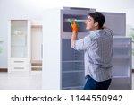 man cleaning fridge in hygiene...   Shutterstock . vector #1144550942