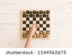 top view on wooden chess board... | Shutterstock . vector #1144562675