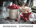 mug of ripe cherries  jar of... | Shutterstock . vector #1144566068