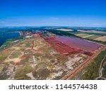 industrial pollution of a huge... | Shutterstock . vector #1144574438
