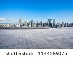 empty square with city skyline... | Shutterstock . vector #1144586075
