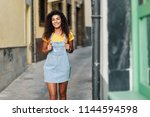 young north african tourist... | Shutterstock . vector #1144594598