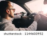 car driver is a businessman in... | Shutterstock . vector #1144603952