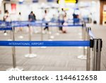 Small photo of Check-in area of an international airport with crowd control barriers.The way passenger queue for check in airplane ticket.