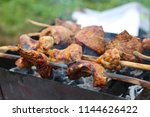 grill the meat on hot coals. | Shutterstock . vector #1144626422