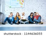 group of students sitting on... | Shutterstock . vector #1144636055