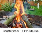 the firewood is burning in the... | Shutterstock . vector #1144638758