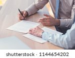 business people signing a... | Shutterstock . vector #1144654202