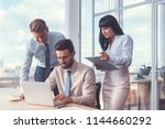 business people with laptop in... | Shutterstock . vector #1144660292