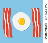 fried egg and meat bacon on... | Shutterstock .eps vector #1144661492