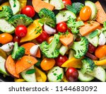 cut seasonal raw vegetables  ... | Shutterstock . vector #1144683092