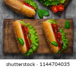 homemade sandwiches sausages... | Shutterstock . vector #1144704035