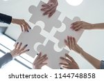hands of business people... | Shutterstock . vector #1144748858