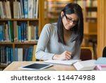 black haired woman studying in... | Shutterstock . vector #114474988