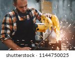 strong mechanic working on... | Shutterstock . vector #1144750025